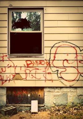 Run down house with graffiti