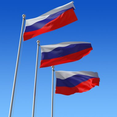 Flag of Russia against blue sky.