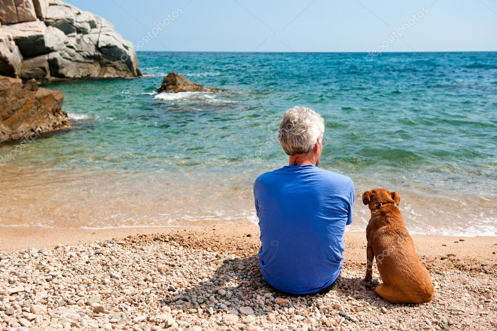 Man with his dog at the beach