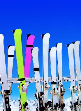 Skis on snow covered place in winter with mountains in the distance stock vector