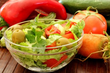 Composition with fresh raw vegetables and Healthy Fresh Salad