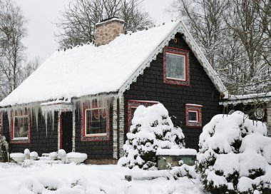 Winter cottage covered by snow