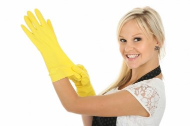 Beautiful blonde housewife putting on yellow latex cleaning gloves stock vector