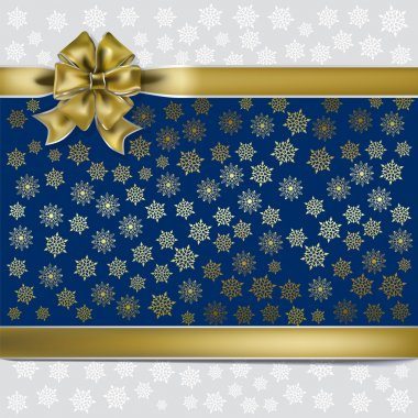 Christmas gold gift ribbon on a snowflakes background