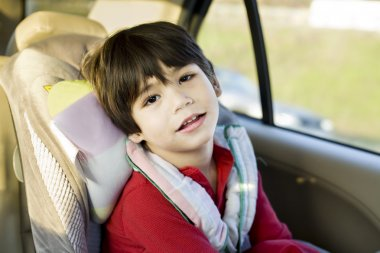 Four year old disabled boy in carseat