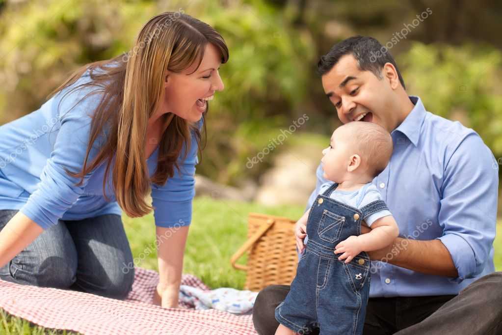 Playful Mixed Race Family In The Park