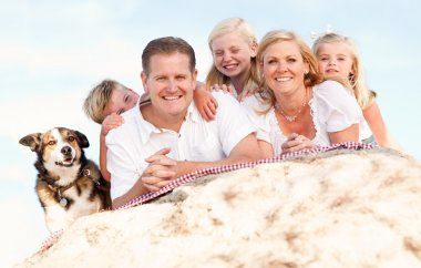 Happy Caucasian Family and Dog Portrait at the Beach