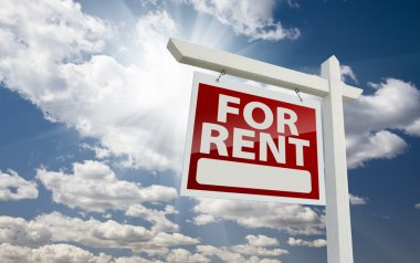 Left Facing For Rent Real Estate Sign Over Sunny Sky