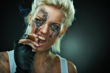 Closeup portrait of a beautiful young punk woman
