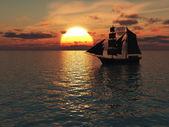 loď na moři při západu slunce