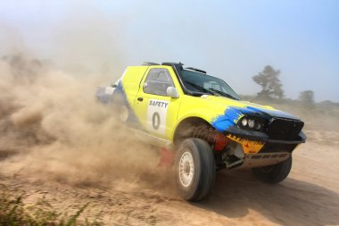 Rally car on dirt road