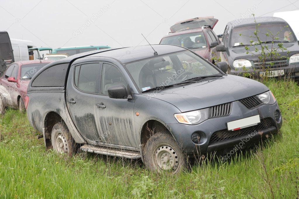Dirt damage cars on grass