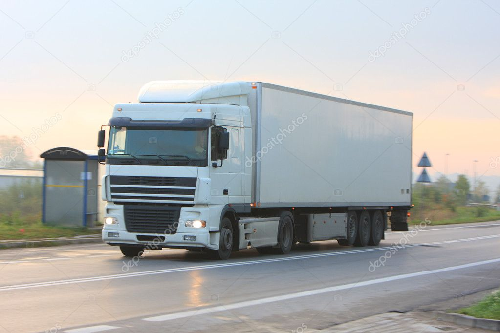 Truck with tank in motion on morning road