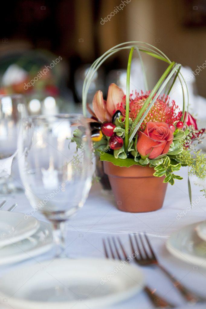 Formal table arrangement with a floral centerpiece