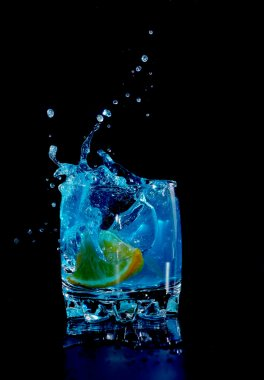Orange in blue water splash