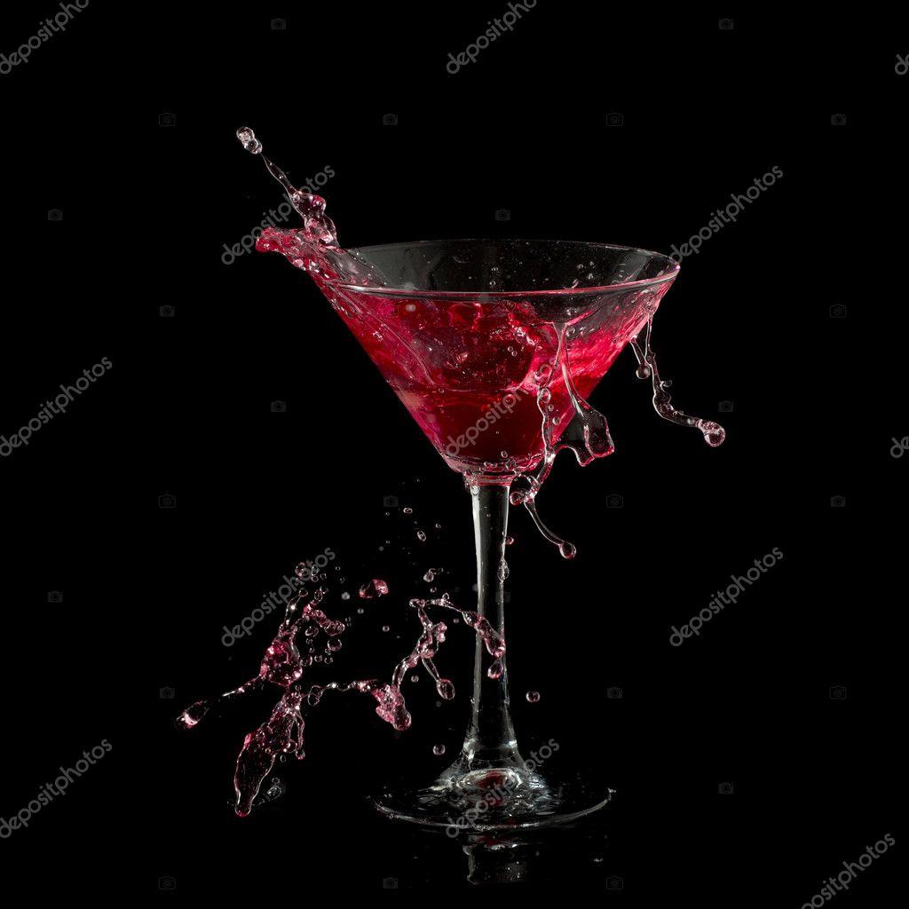 Red martini cocktail splashing