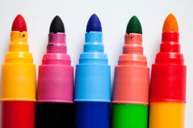 Felt tip pens in row on white
