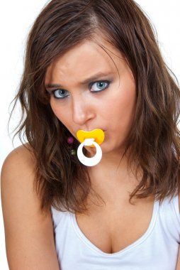 Frightened girl sucking a pacifier