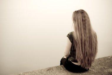 Suicide concept - back of sad depressed woman