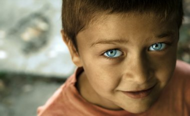 Cute kid with blue eyes