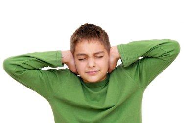 Teenage boy with arms on ears