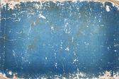 Fotografia cartone blu con segni di età