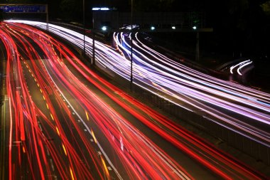 Night highway (Cars in a rush moving fast on a highway (speedway