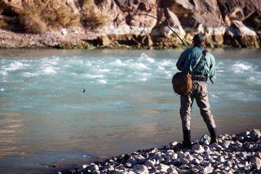 Fishing on mountain river