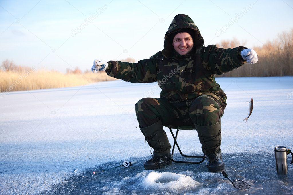 Fisherman on winter lake