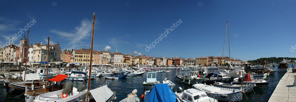 Panoramic landscape with the sky, the sea and the port city of Porec, Croat