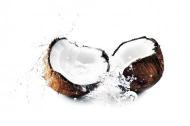 Cracked coconut splashing