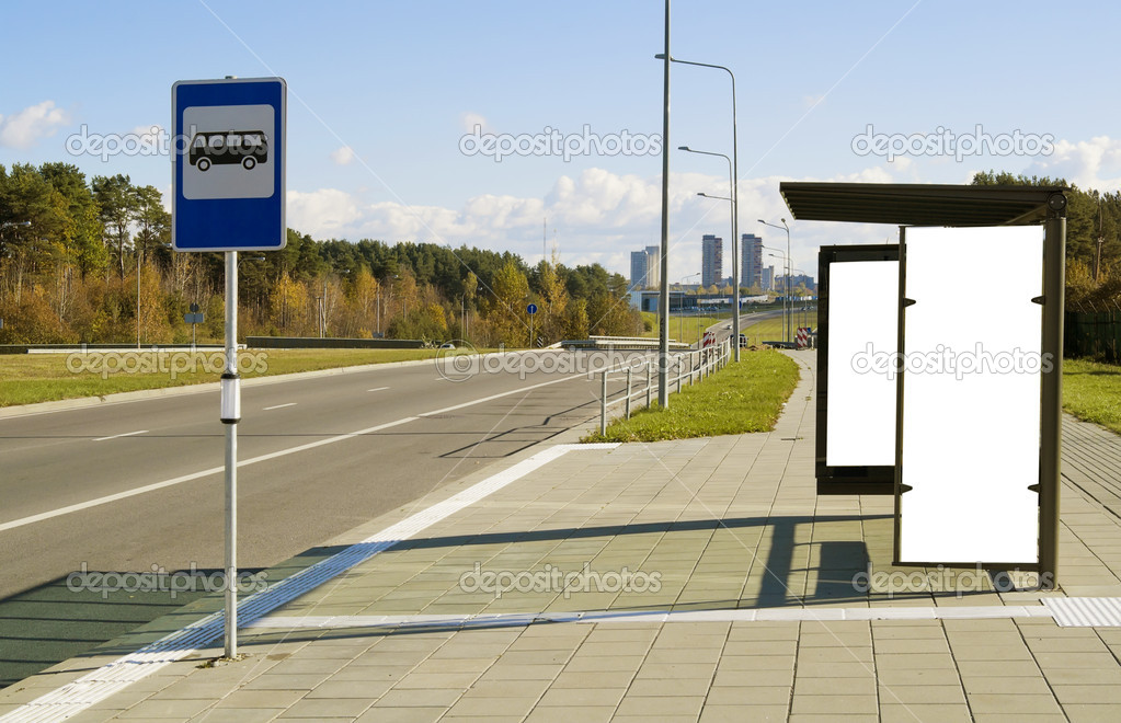 Bus stop on a high-speed highway near to a megacity