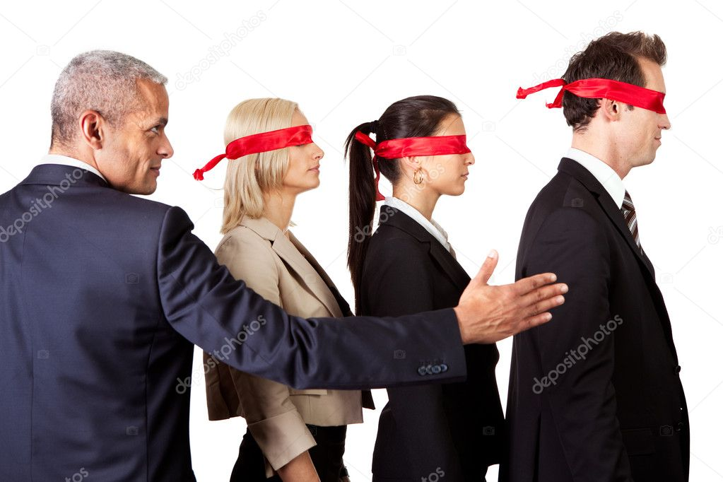 Businessman showing the way for group of disoriented businesspeople