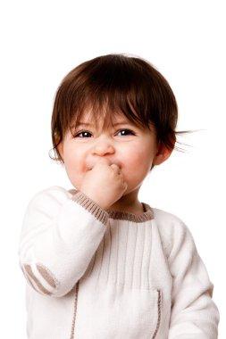 Cute mischievous baby toddler face