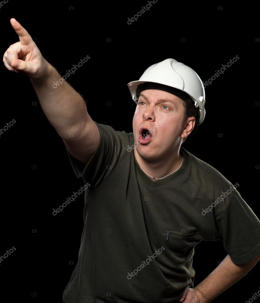 Worker in white helmet pointing to something