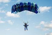 The girl parachutist in dark blue overalls
