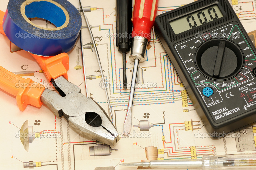 Tools On A Background Of The Electric Scheme Stock Photo