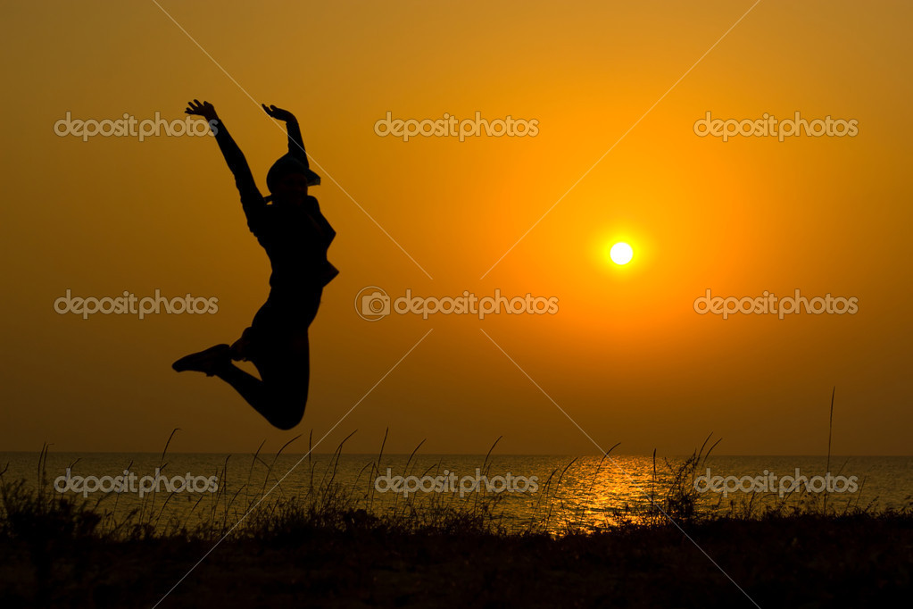 Jumping girl silhouette.