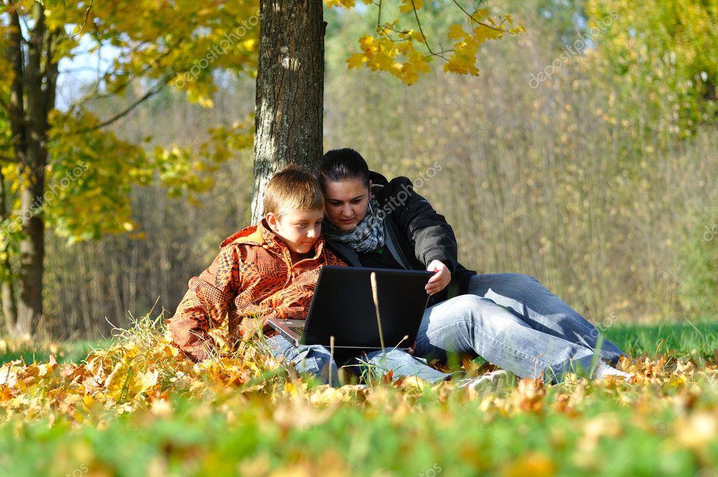 Family in park on autumn