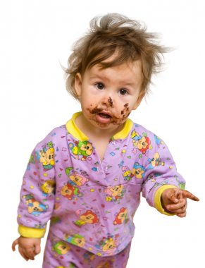 Curious toddler with chocolate dirty face