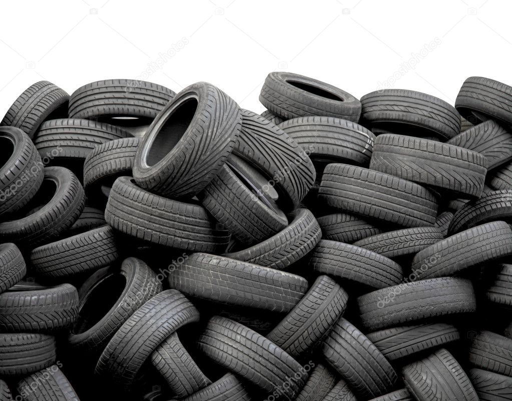 wall of old car tires on white background photo by marischka