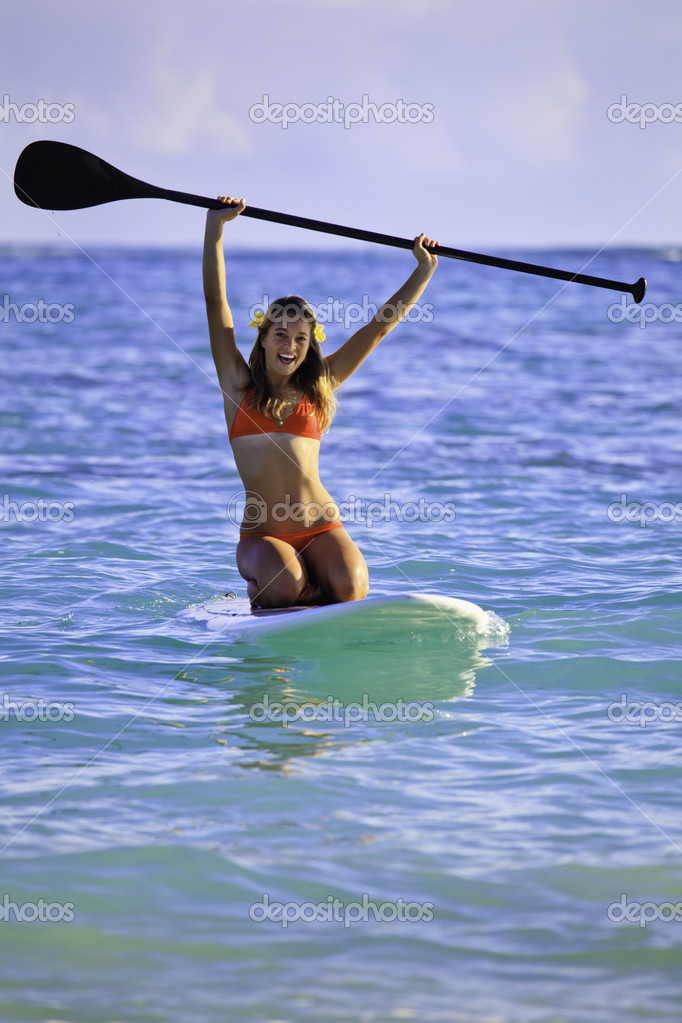 Teenage girl on a stand up paddle board