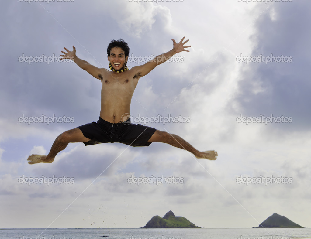 Asian man jumping in the air