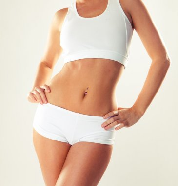 Slim tanned woman's body.
