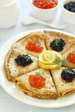 Traditional Russian pancakes with red and black caviar