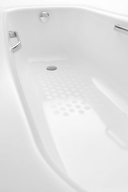 White ceramic bath tub. It is isolated on white background.