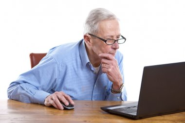 Senior man behind the computer