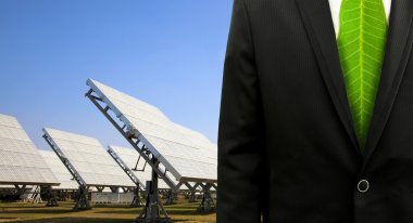 Green business concept.business man with solar power plant