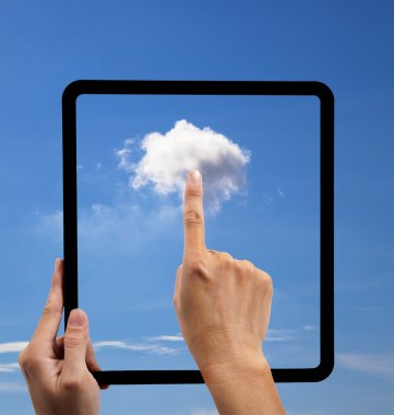 Cloud computing and touch pad concept. hand holding black empty frame and t