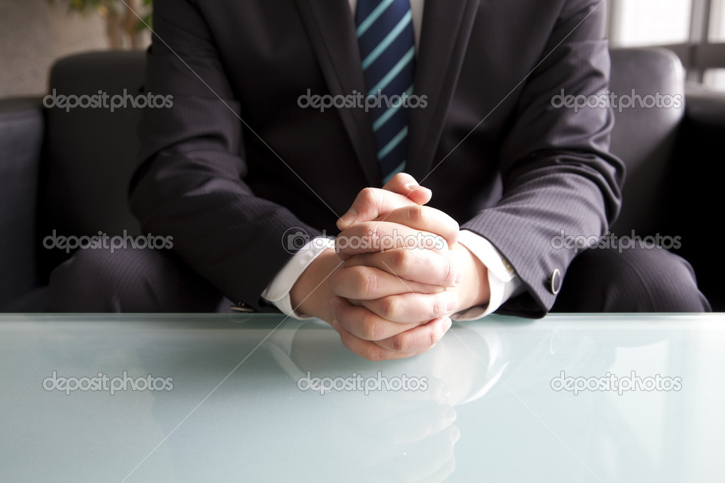 Holding hand of businessman